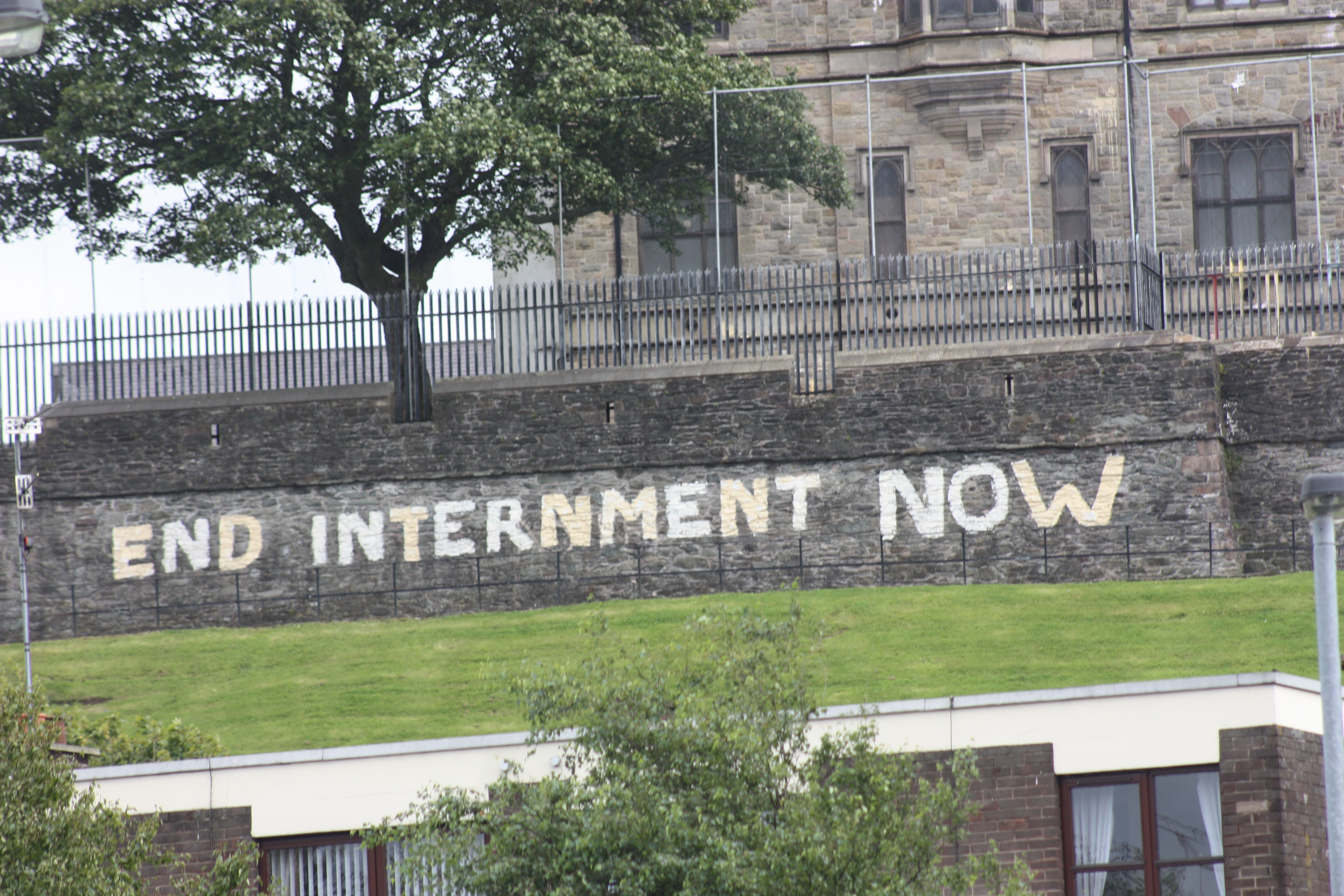 Painting reading End Internment Now on Derry City Wall facing nationalist estate Bogside, 2009