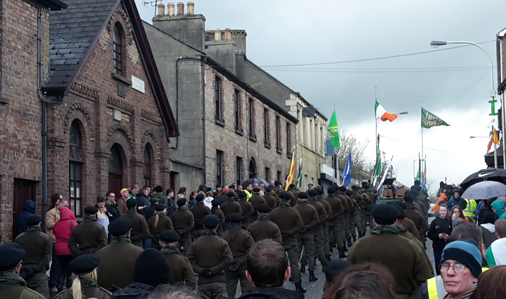 Republican Coalisland Easter Commemoration 2016, women and men standing in paramilitary uniform in Town Centre
