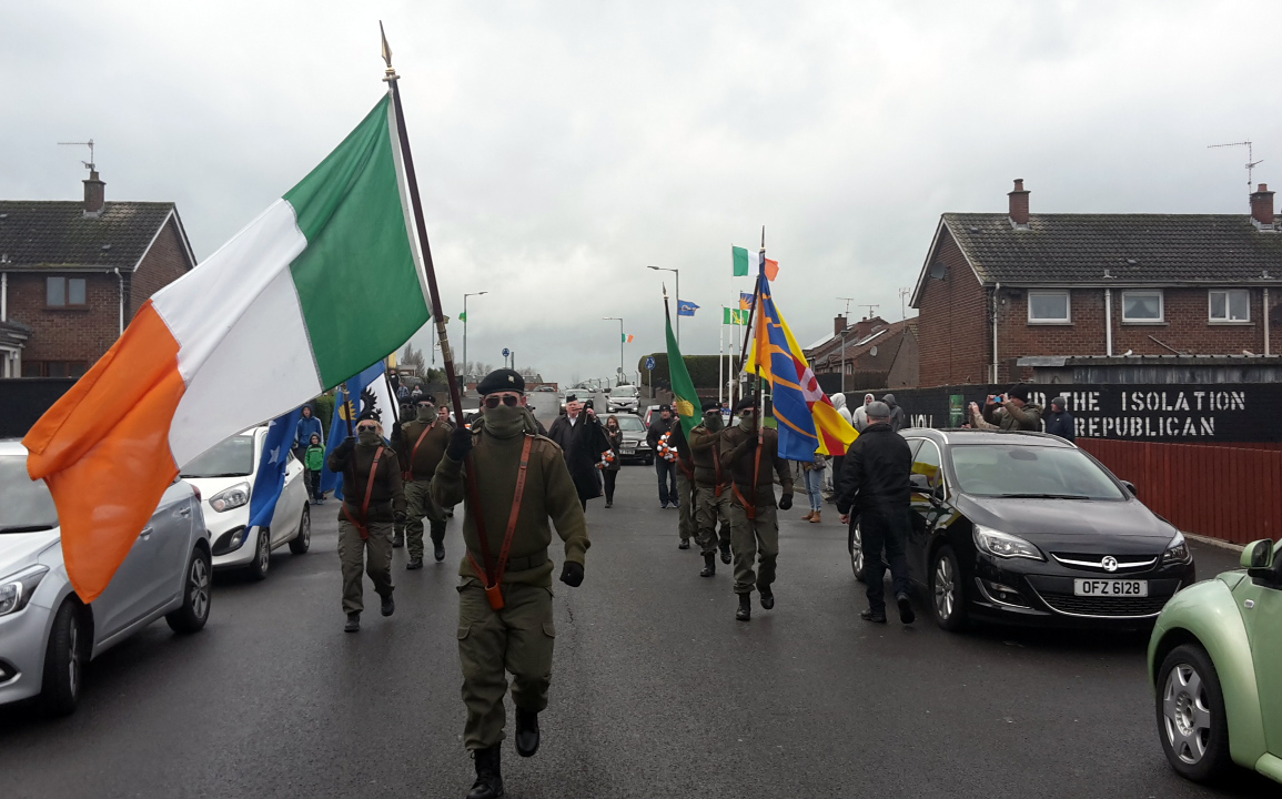 Lurgan Easter Commemoration 2016 organised by Republican Sinn Féin, masked women and men in paramilitary uniforms marching through the Nationalist Kilwilkee estate.